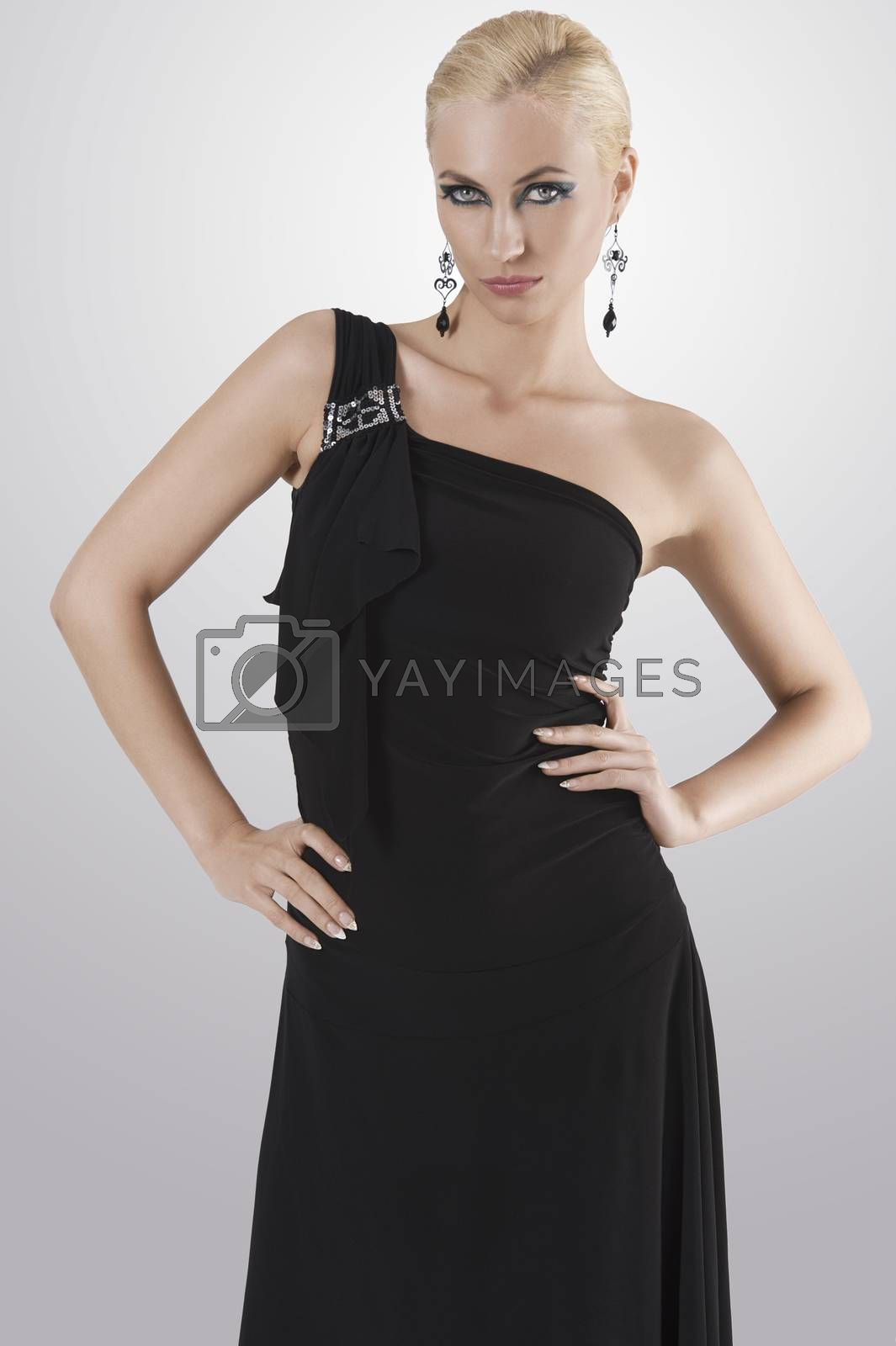 Royalty free image of blond girl in black dress posing towards the camera by fotoCD