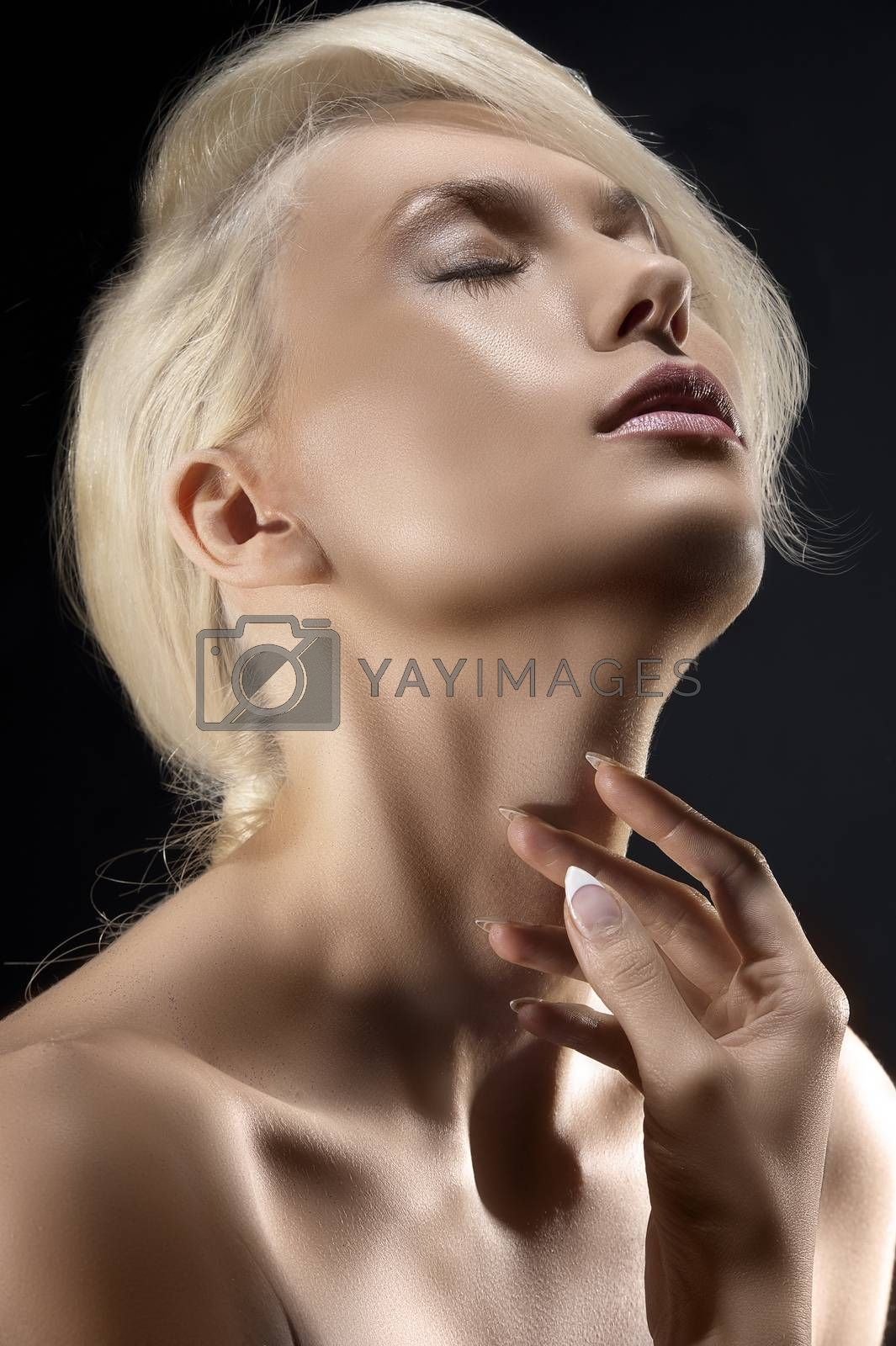 Royalty free image of blond young girl in emotive portrait by fotoCD