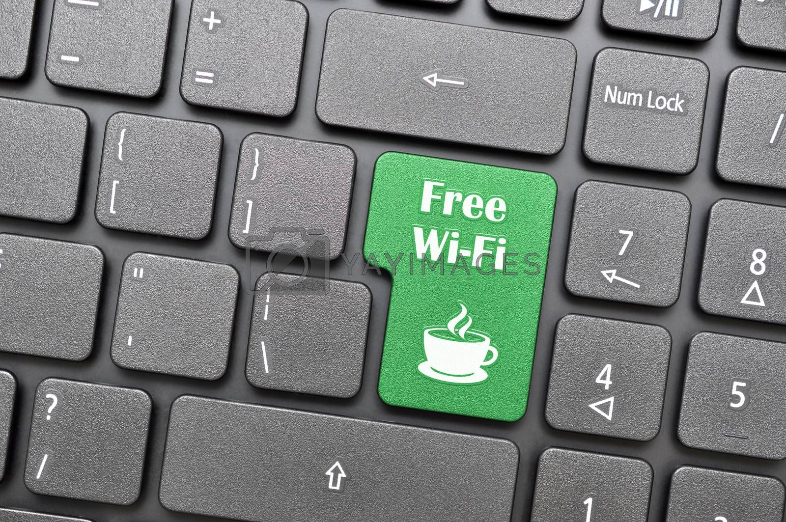 Royalty free image of Free wifi in coffee shop on keyboard  by payphoto