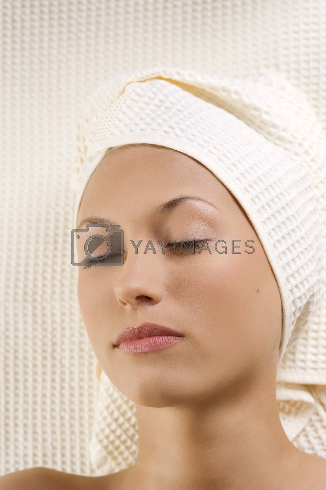 Royalty free image of woman in spa with closed eyes by fotoCD
