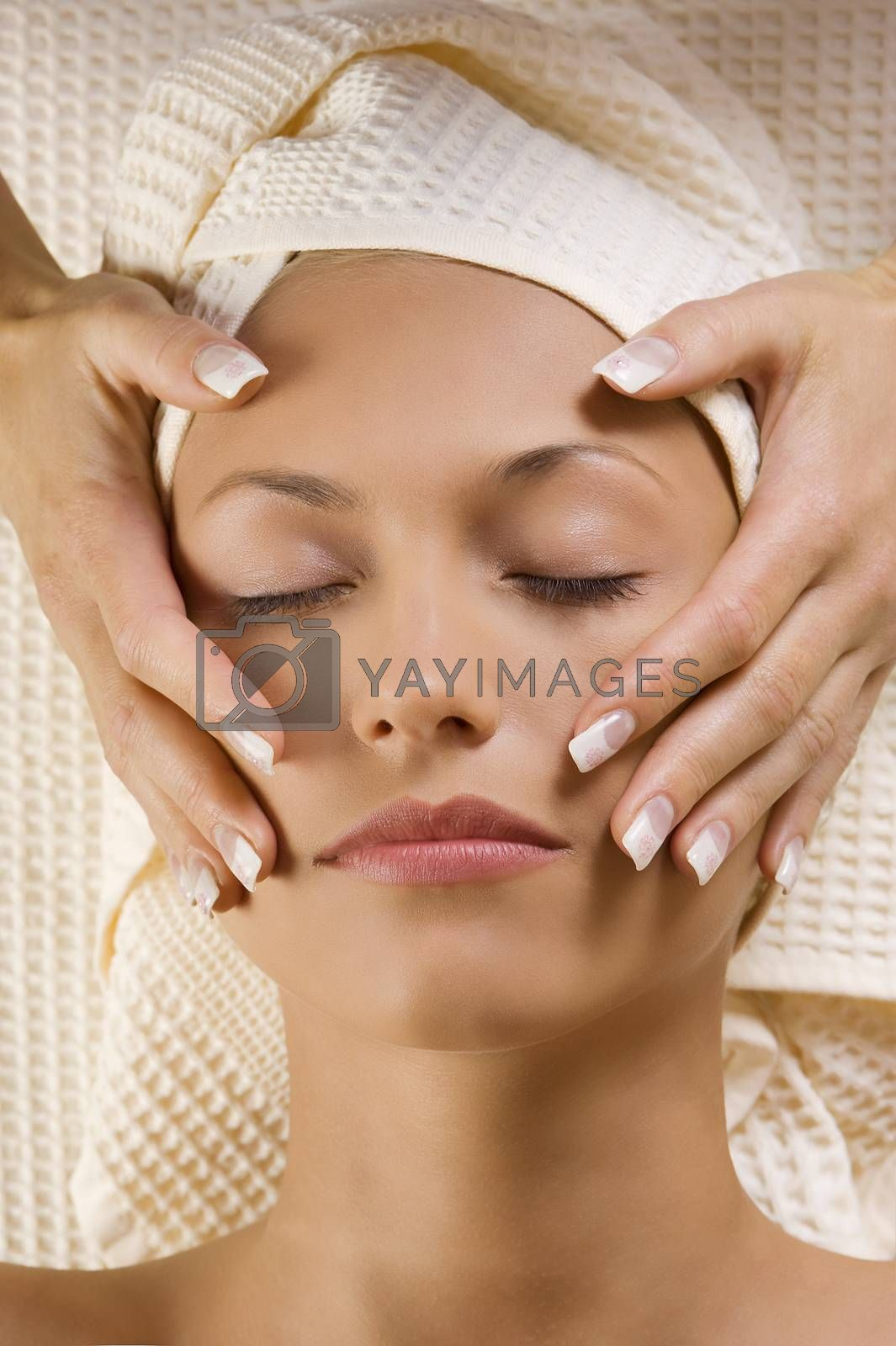 Royalty free image of hands massage near head by fotoCD