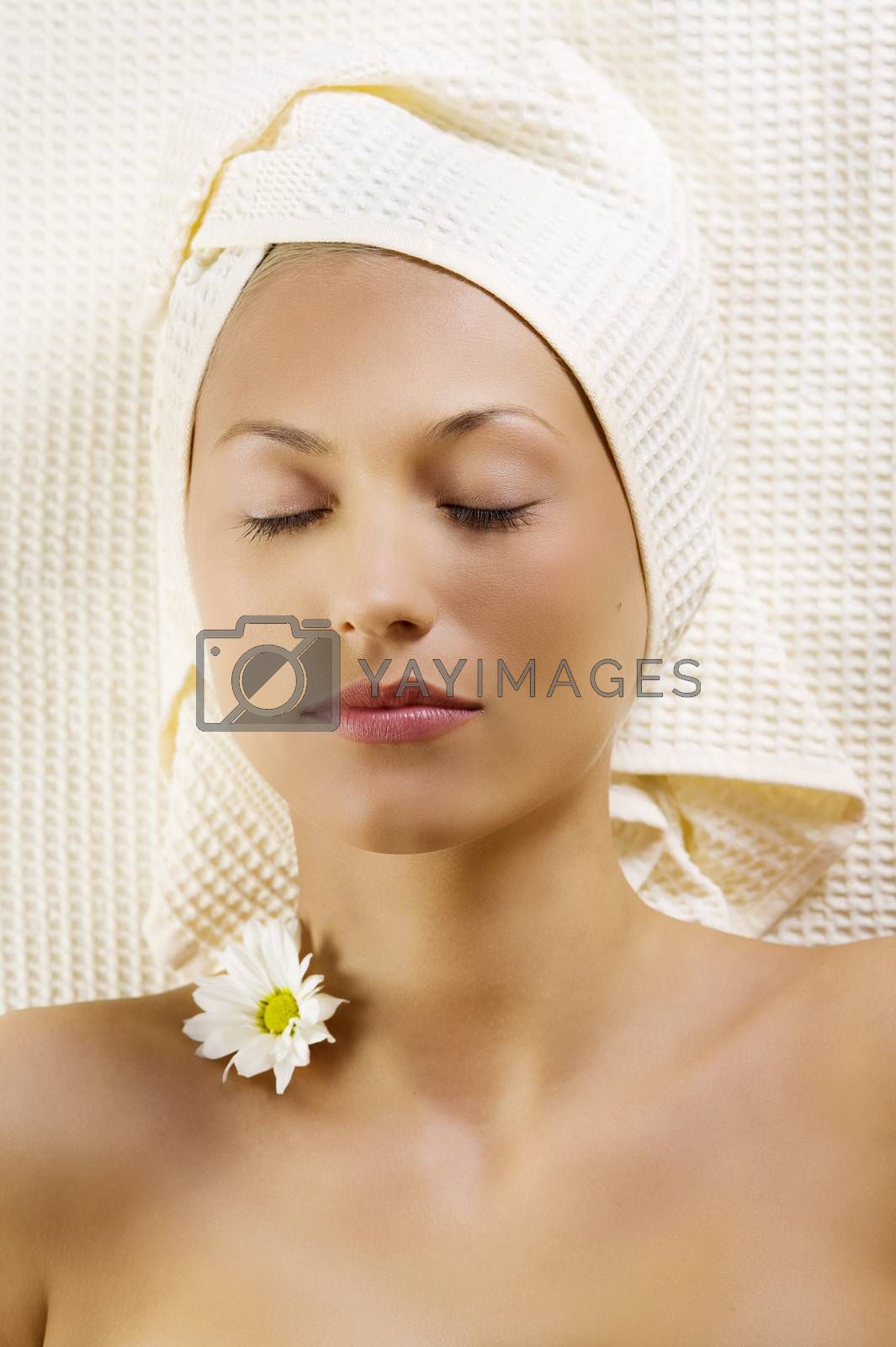 Royalty free image of cute girl in spa with flowers by fotoCD