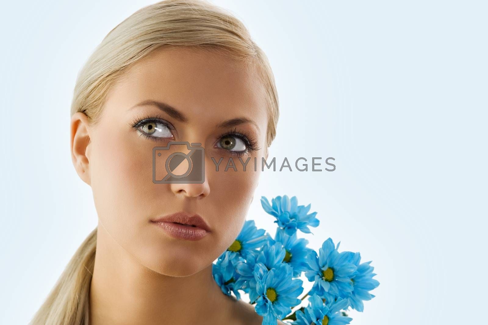 Royalty free image of blond girl and blue daisy by fotoCD