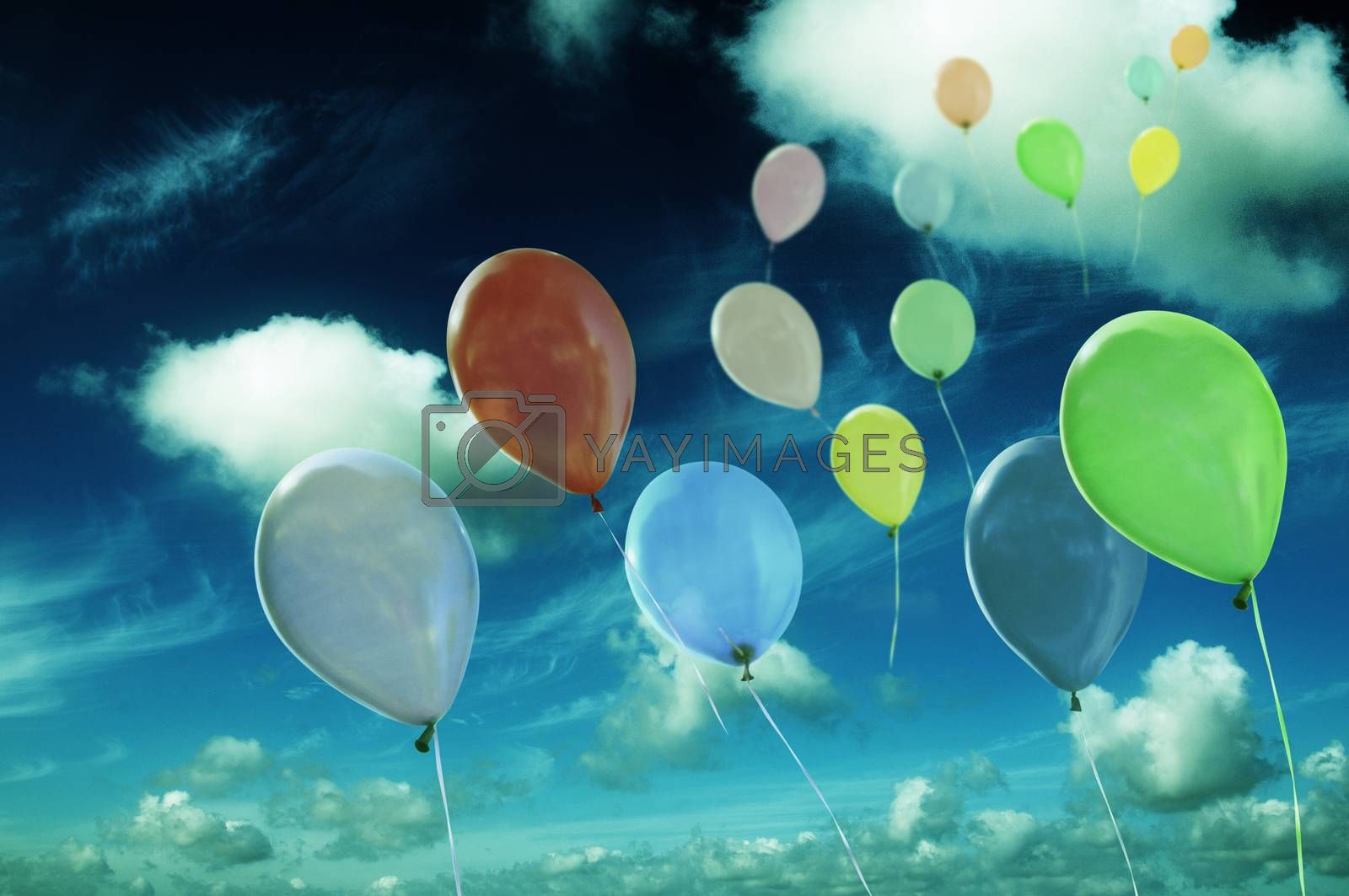 Royalty free image of colored ballons against cloudy sky by fotoCD