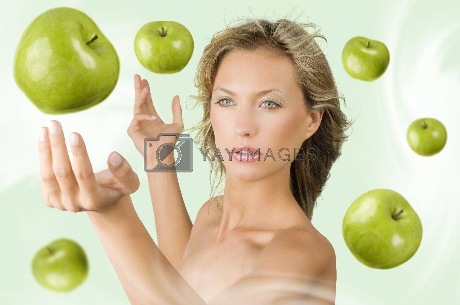 Royalty free image of girl with flying apple by fotoCD