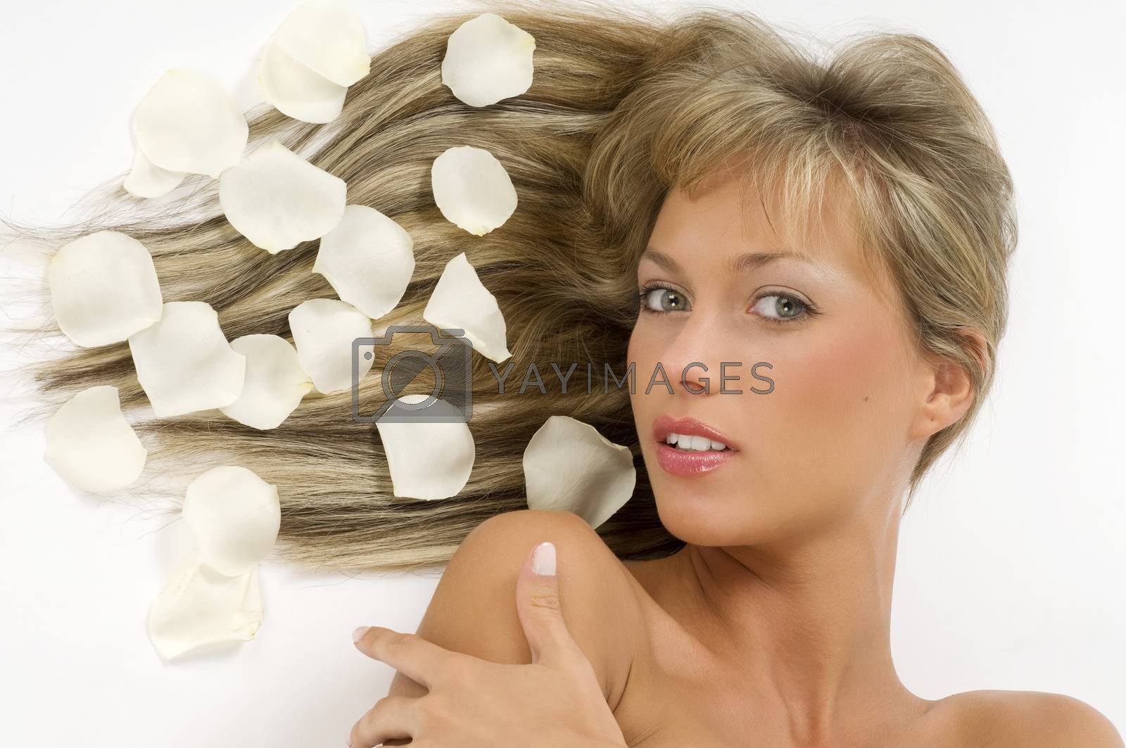 Royalty free image of blond girl petals by fotoCD