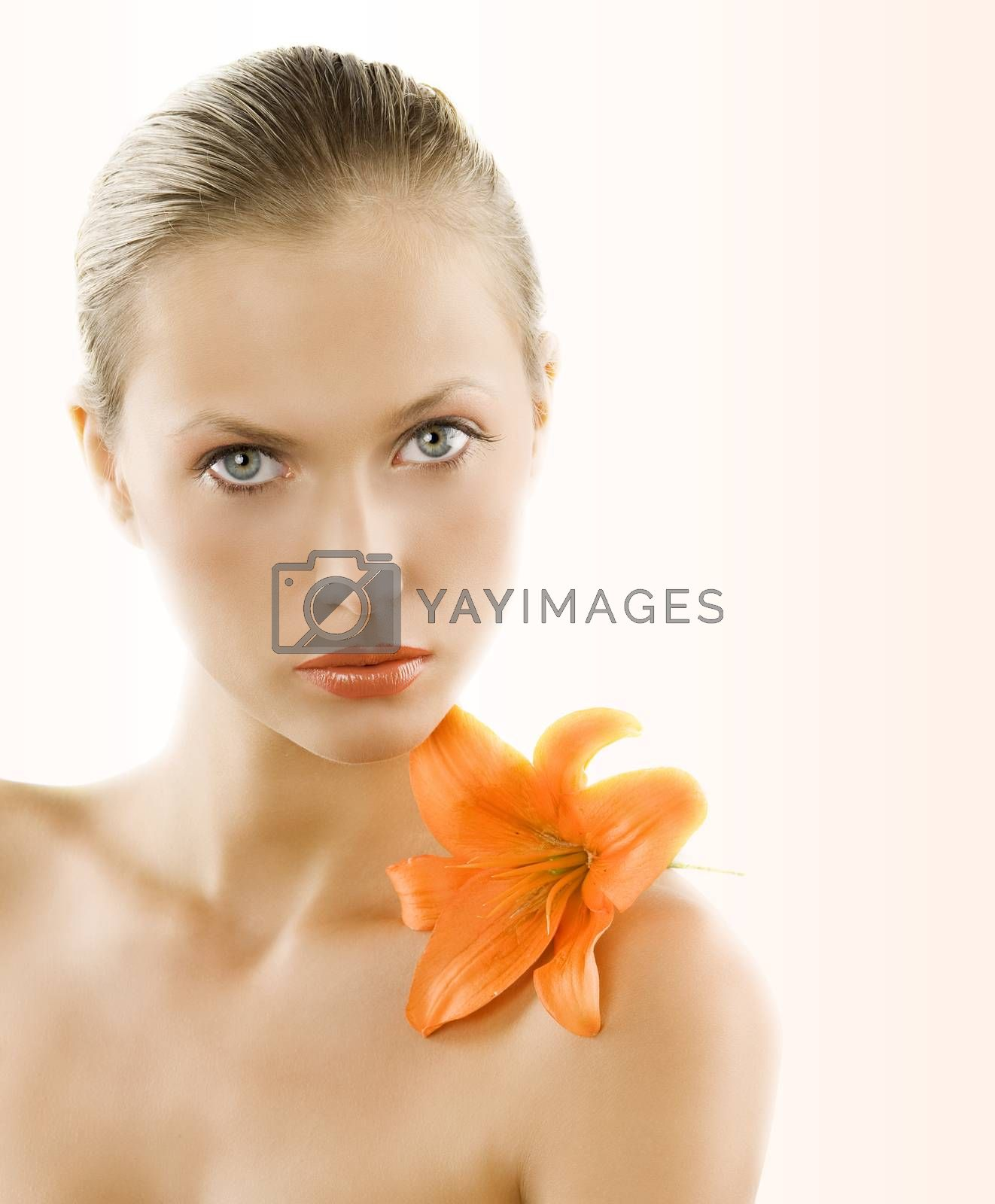 Royalty free image of portrait with orange lily by fotoCD