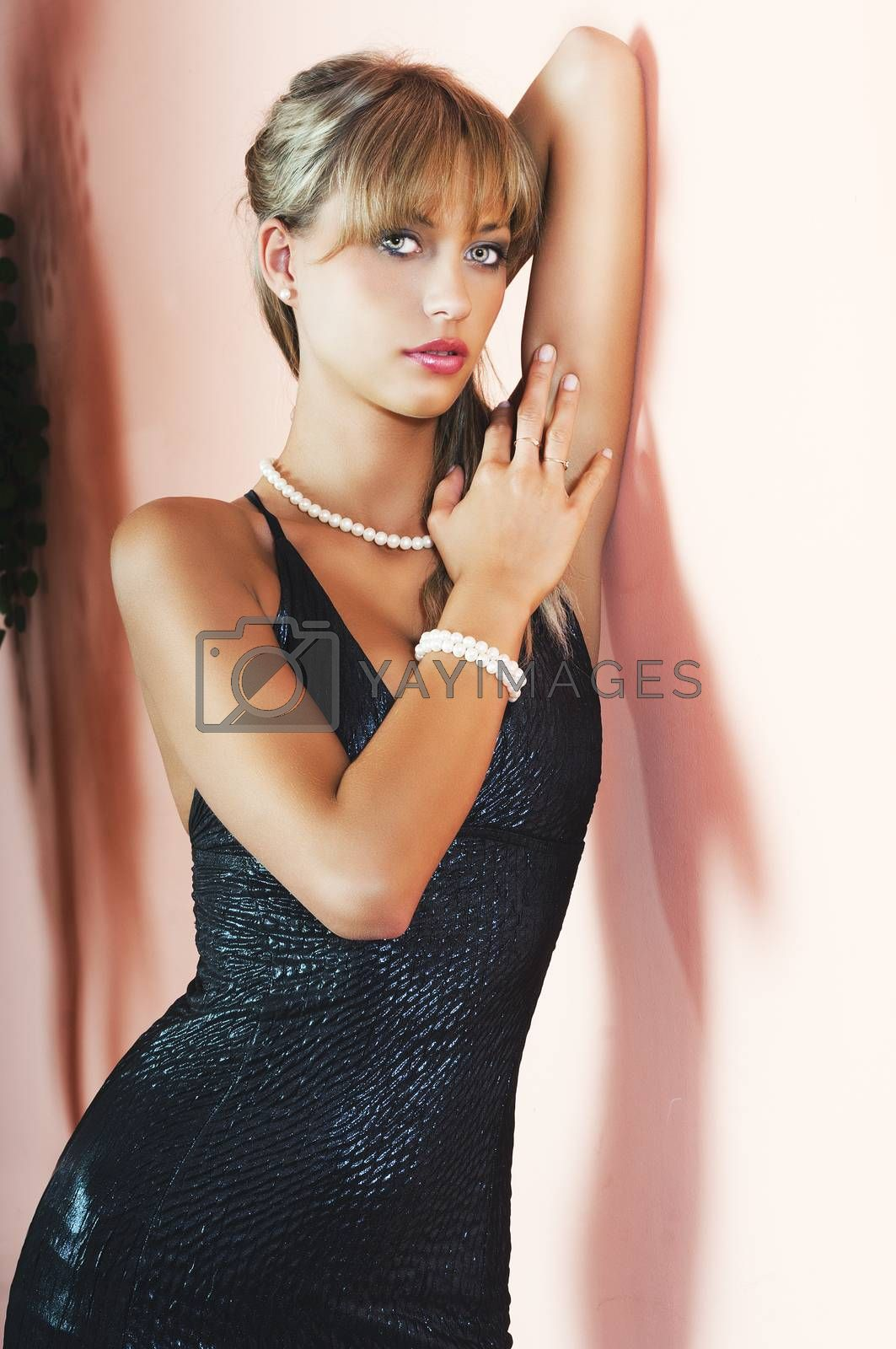 Royalty free image of pretty blonde girl with left arm near the face by fotoCD