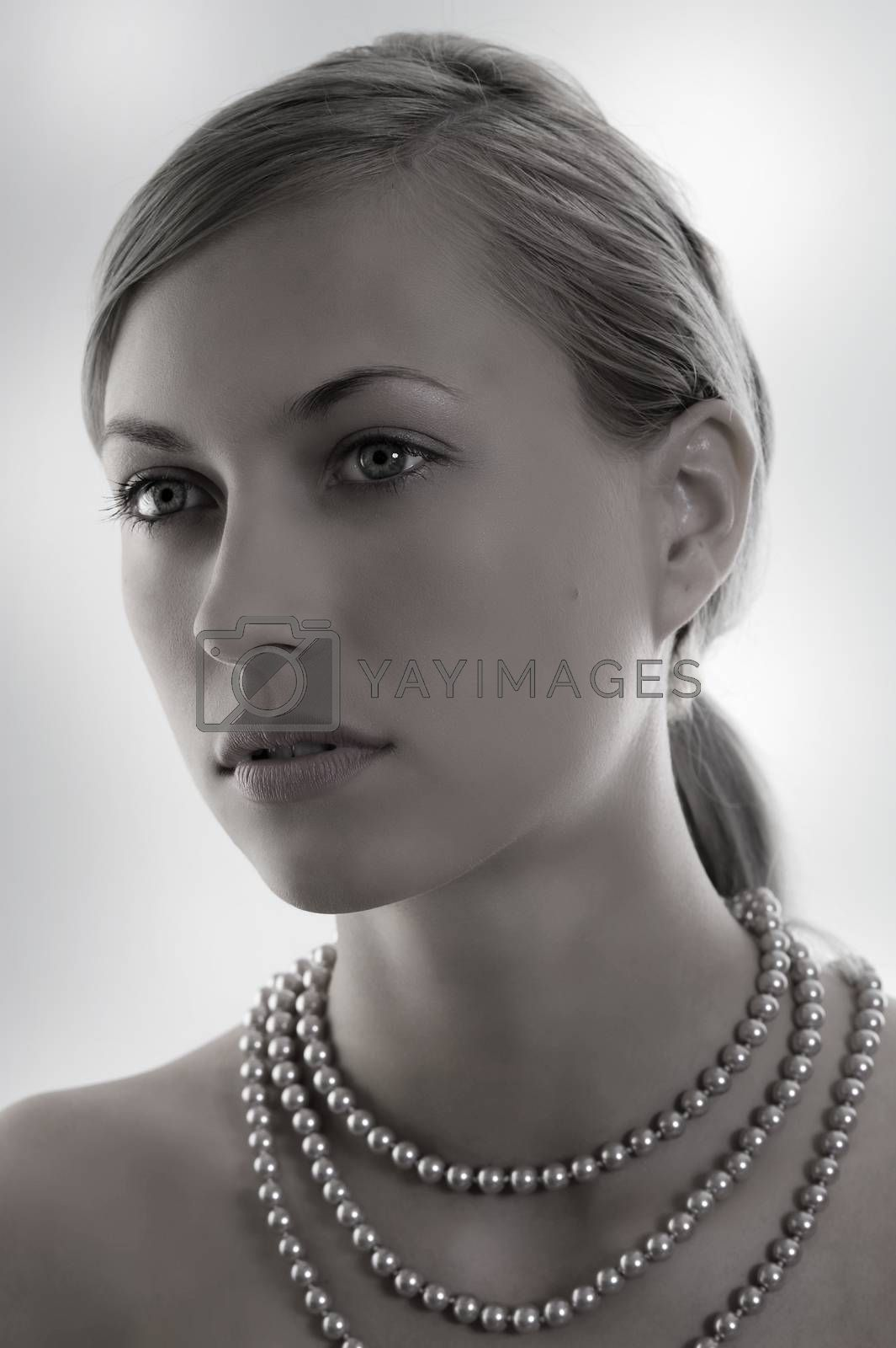 Royalty free image of desaturate lady with pearl by fotoCD
