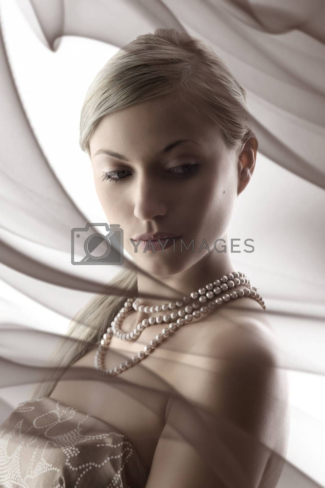 Royalty free image of blond with nacklace by fotoCD