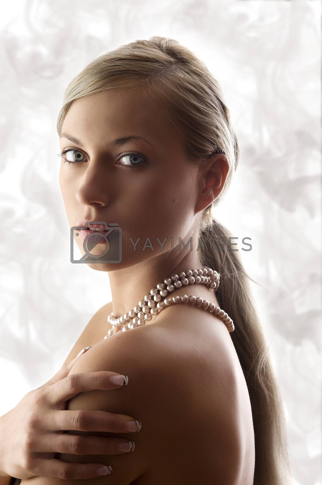 Royalty free image of blond woman with pearl by fotoCD