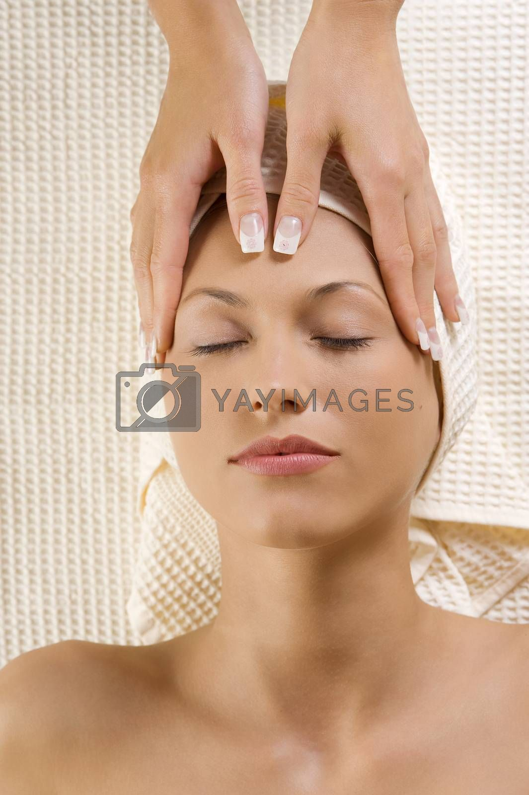Royalty free image of hands massage on head by fotoCD