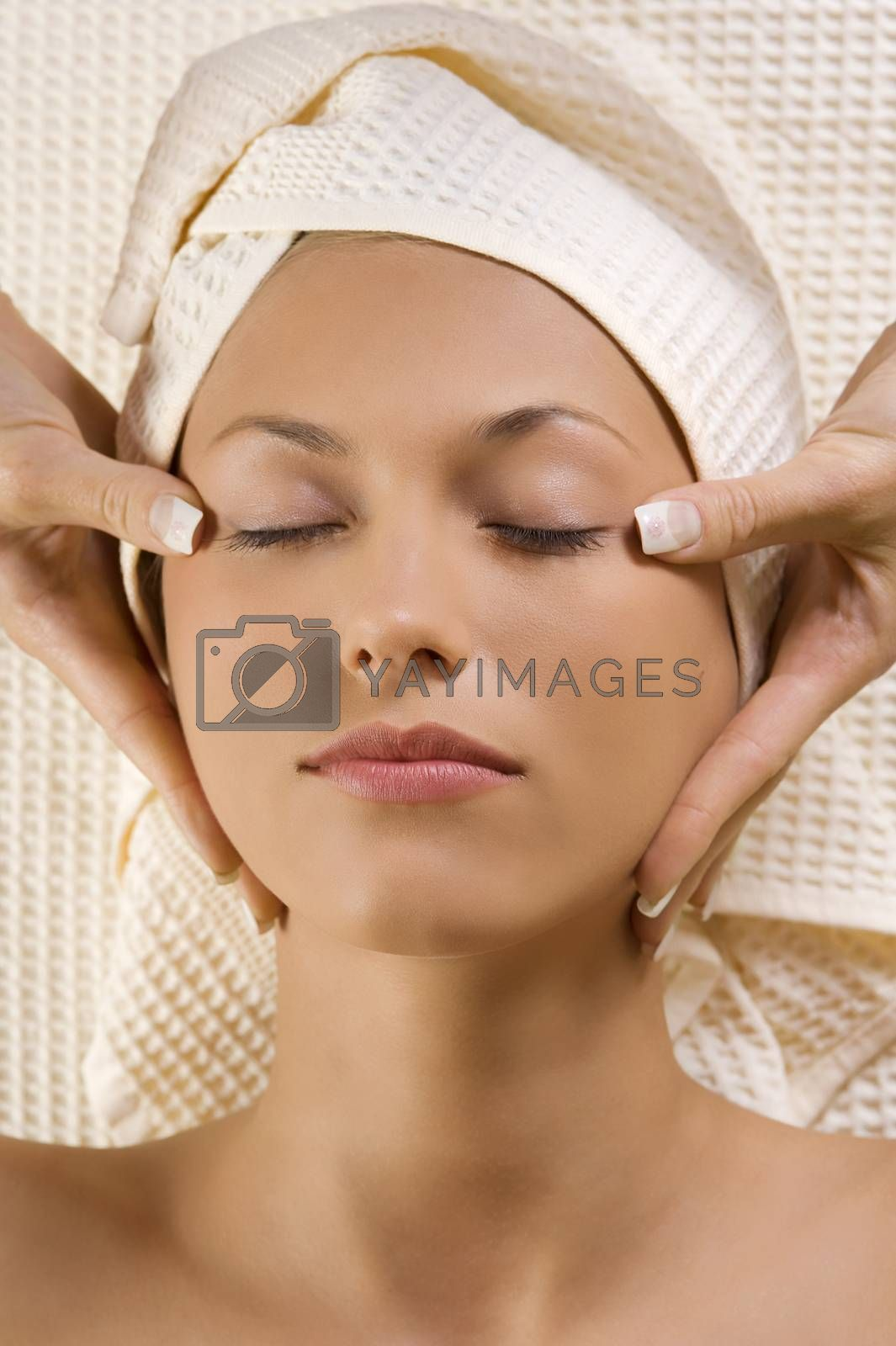 Royalty free image of hands massage on head temple by fotoCD