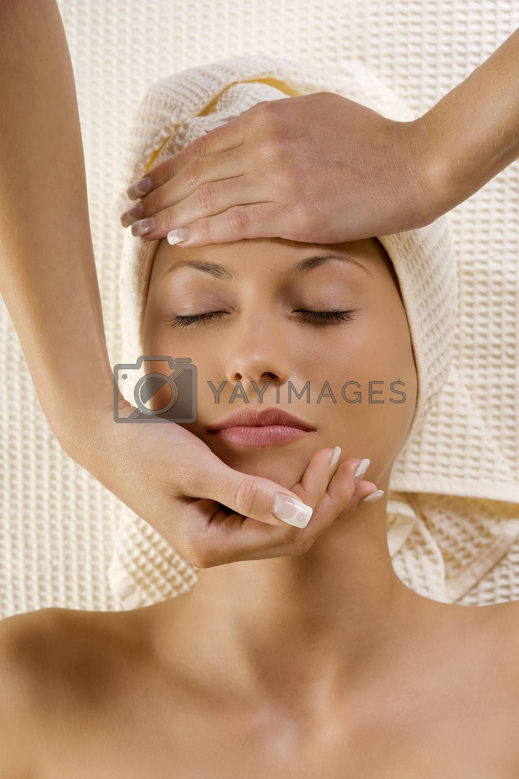 Royalty free image of stretching head with hands by fotoCD