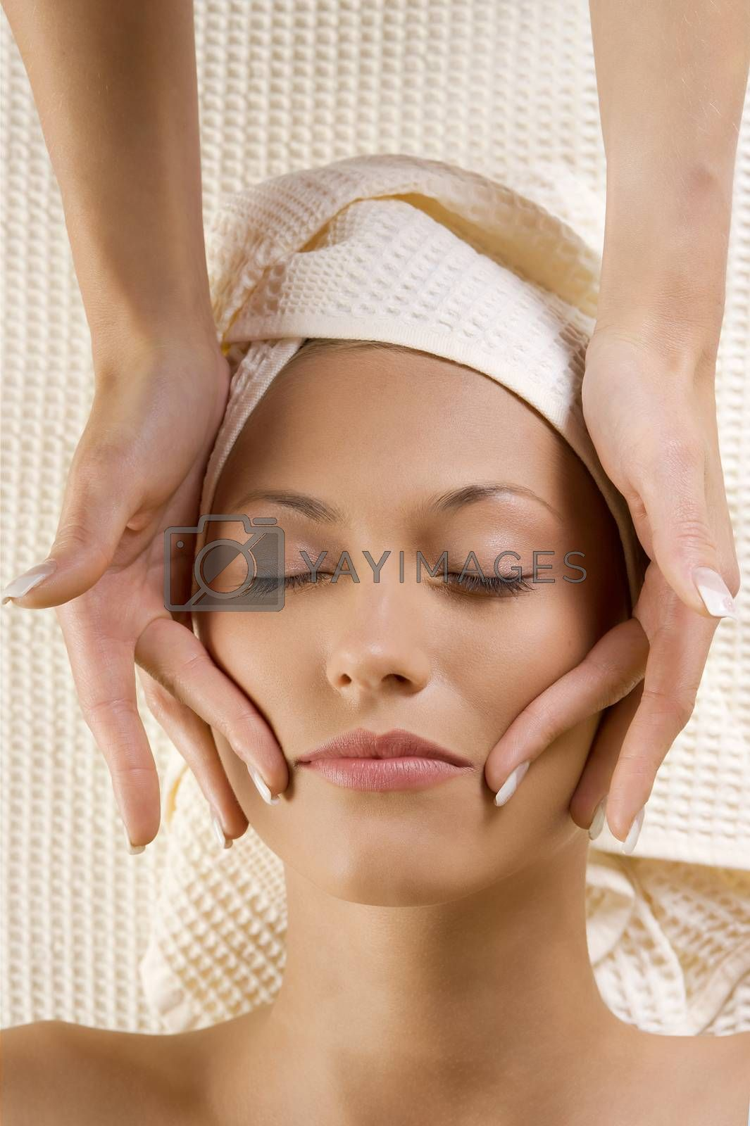 Royalty free image of hands massage on face by fotoCD