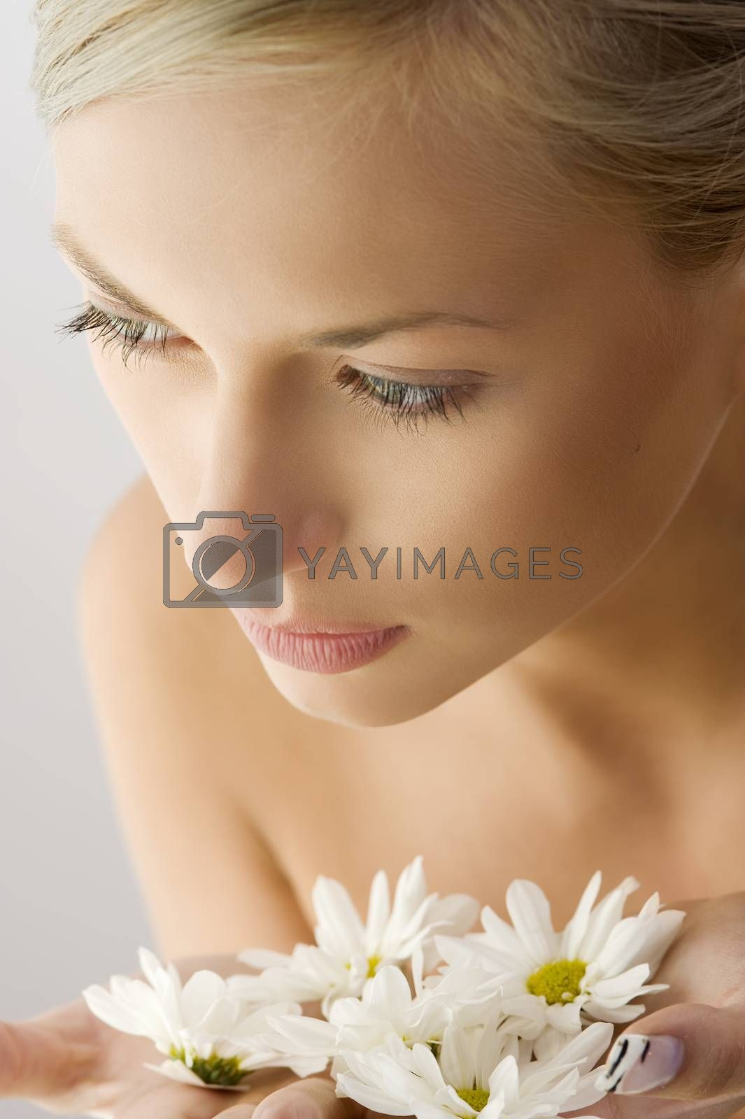 Royalty free image of beauty girl with flower by fotoCD