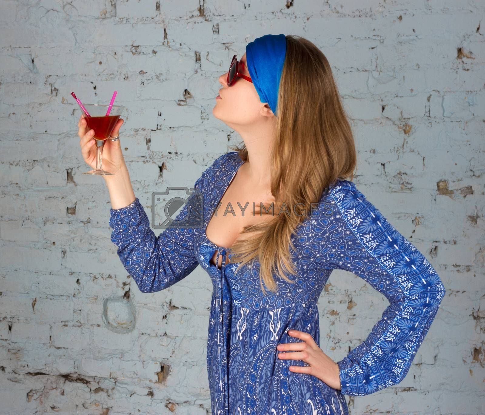 Royalty free image of woman drinking a cocktail by victosha