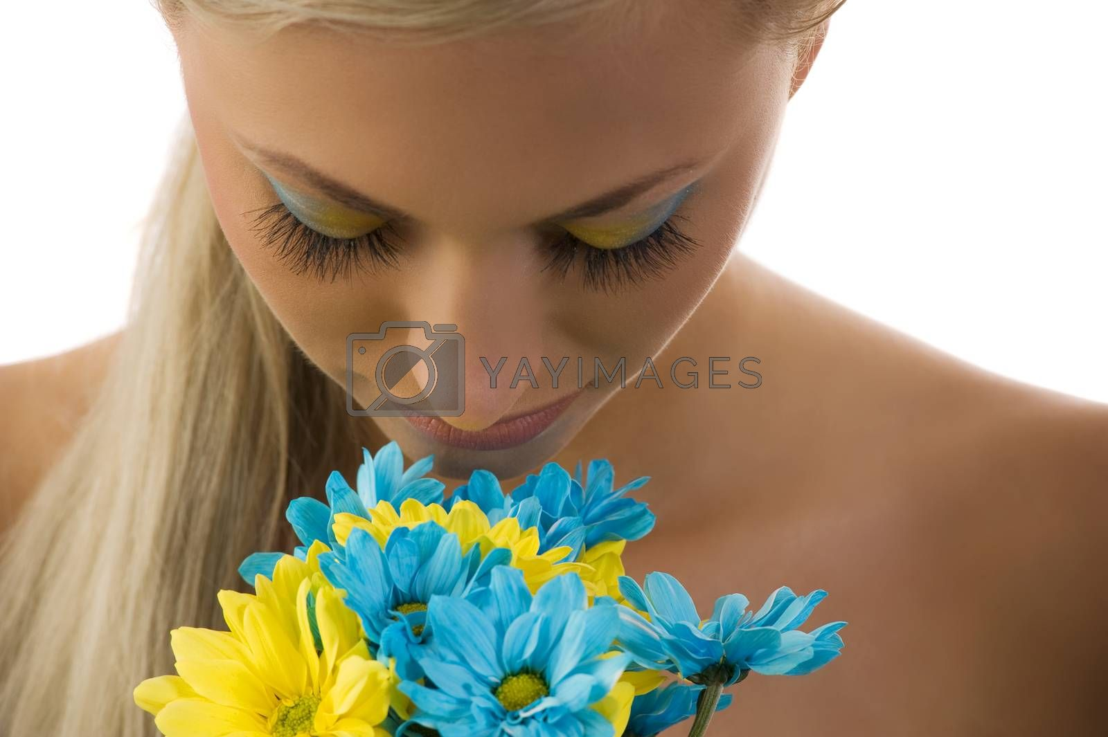 Royalty free image of smelling flowers by fotoCD