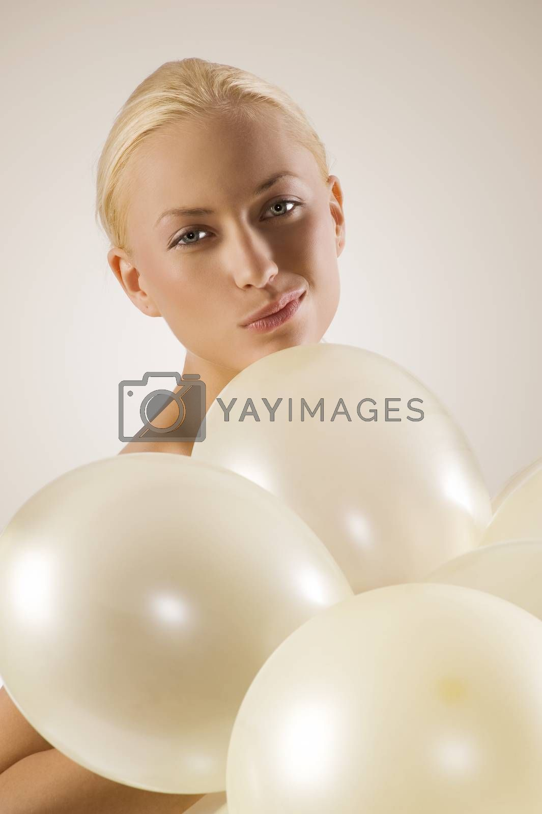 Royalty free image of girl with ballons making face by fotoCD