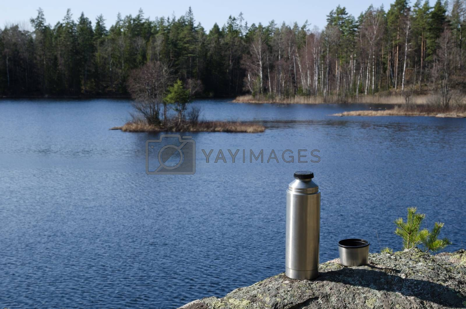 Royalty free image of Thermos by forest lake side by olandsfokus