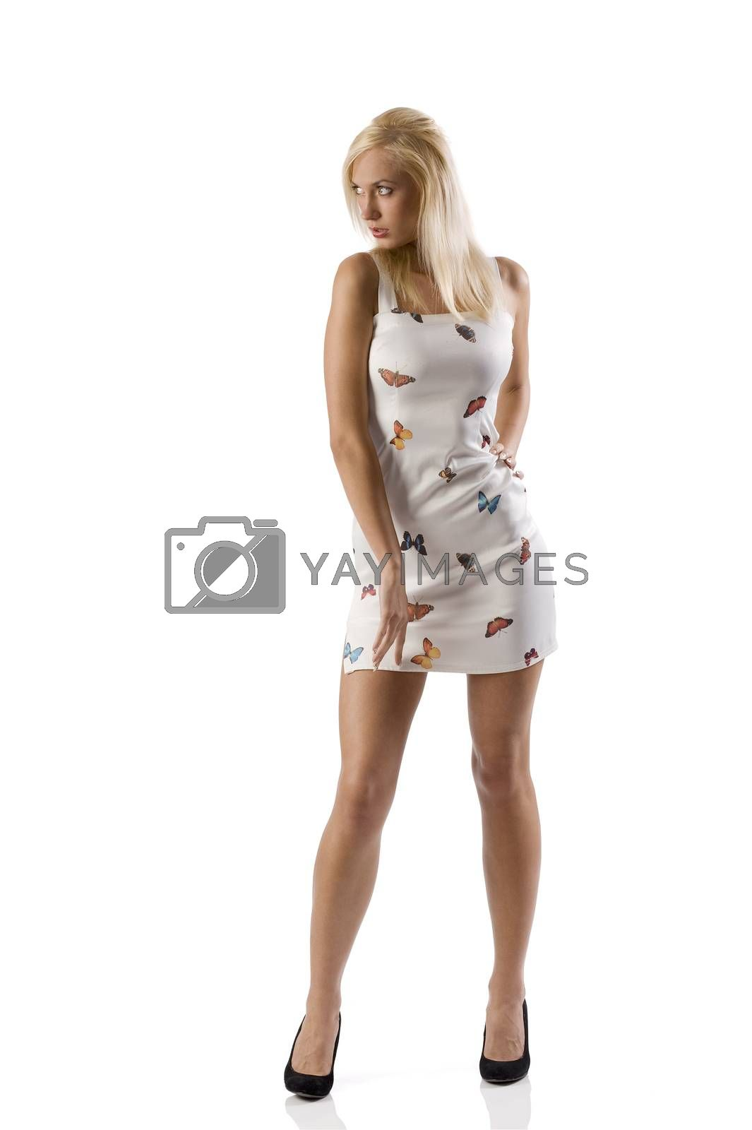 Royalty free image of sexy blond with white dress by fotoCD