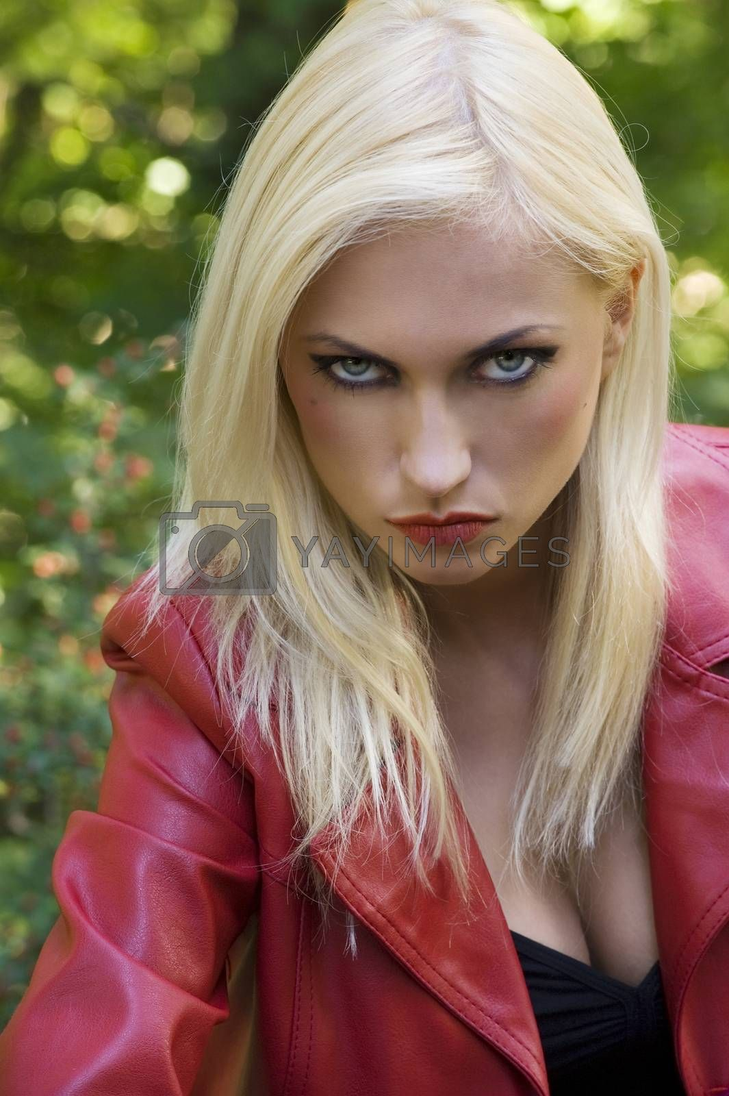 Royalty free image of blond girl anger in park by fotoCD