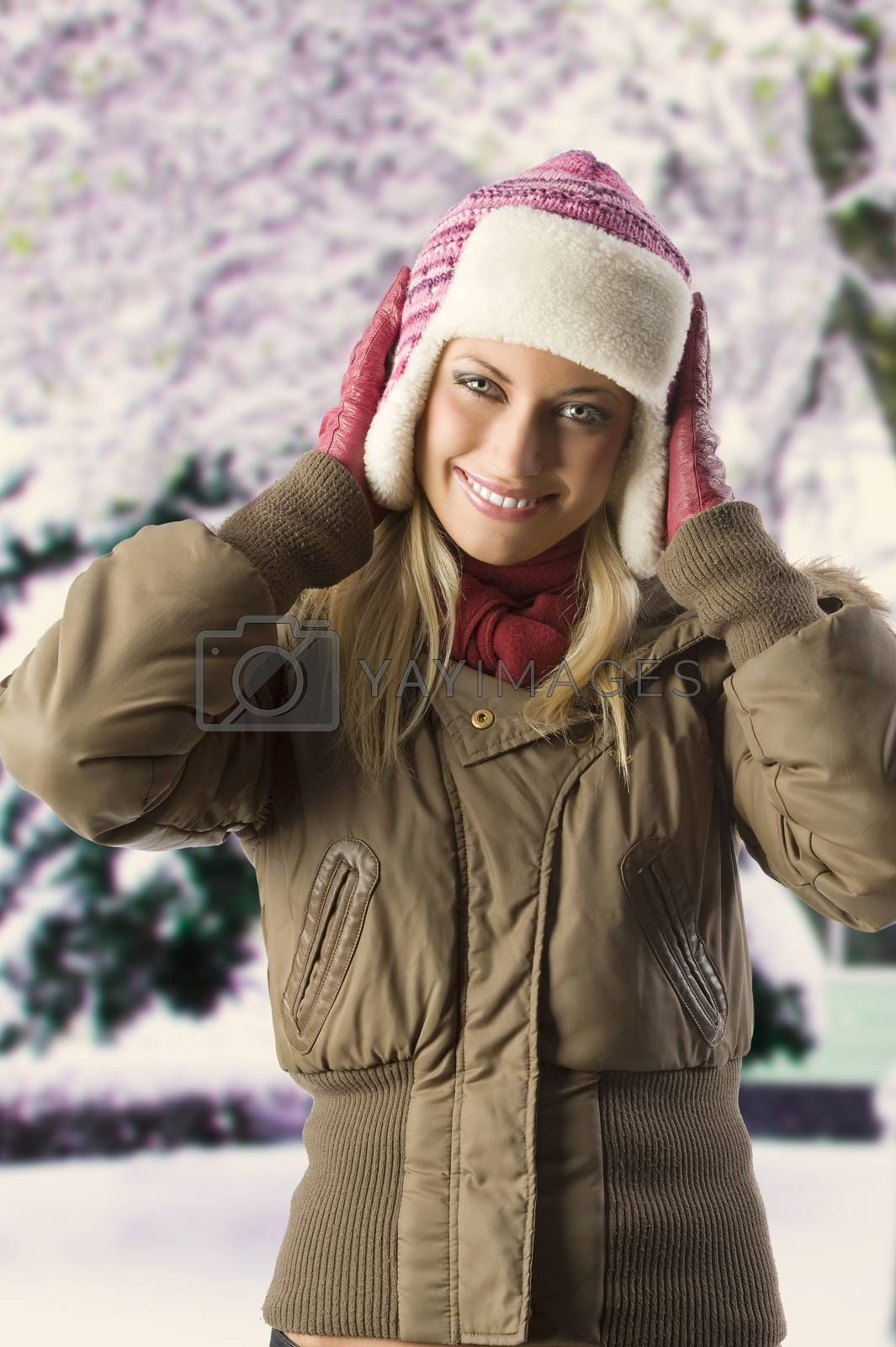 Royalty free image of girl with winter dress by fotoCD