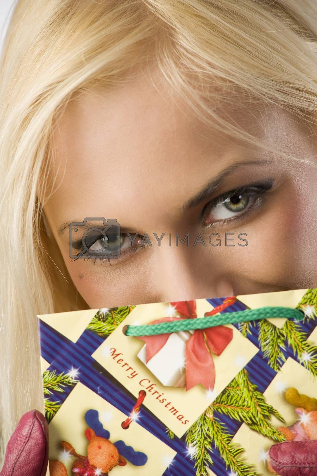 Royalty free image of playing with christmas beg by fotoCD