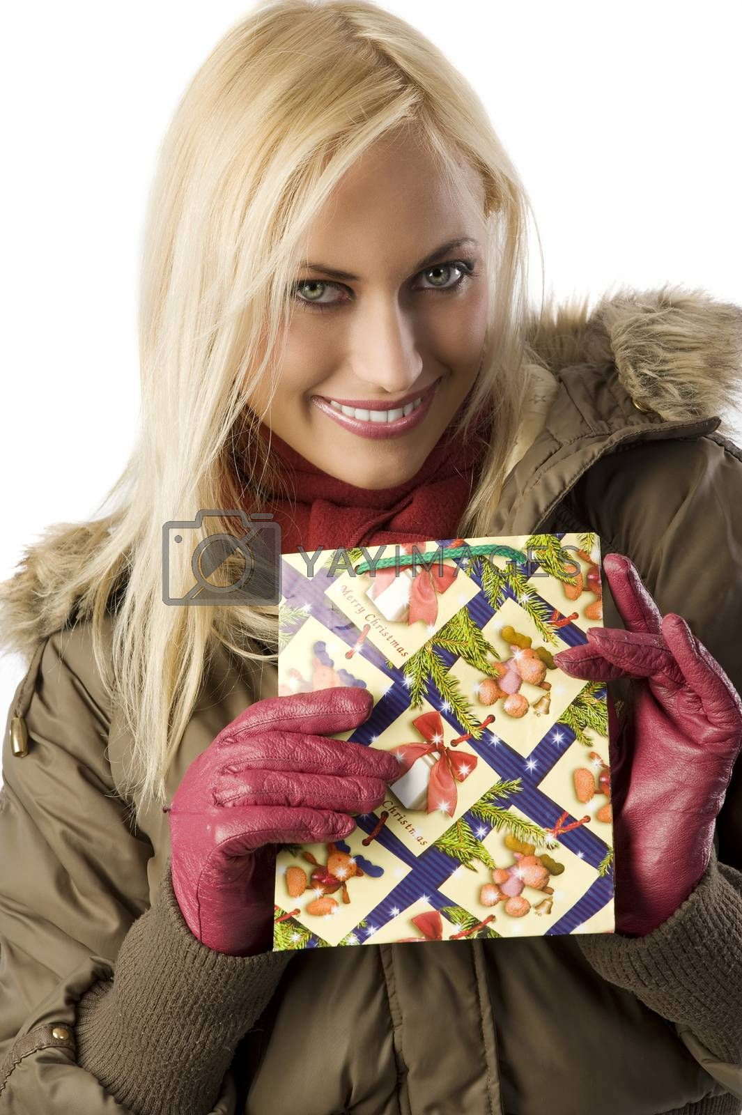 Royalty free image of blond girl with christmas bag by fotoCD