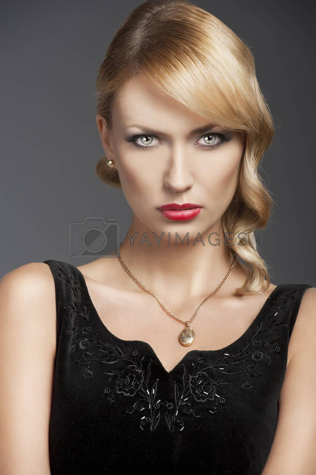 Royalty free image of old fashion blond girl, in front of the camera by fotoCD