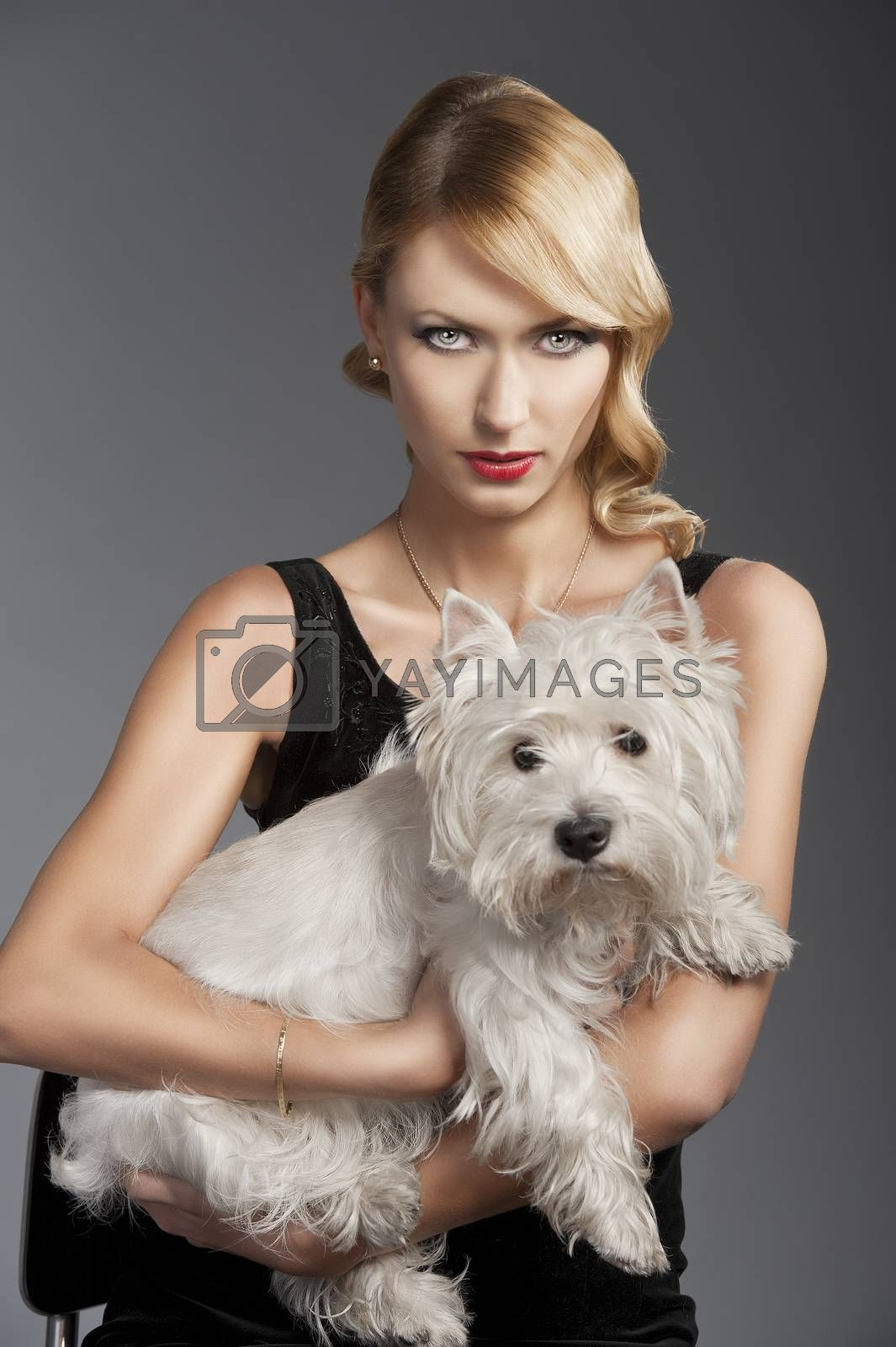 Royalty free image of old fashion blond girl,she has a dog in her arms by fotoCD
