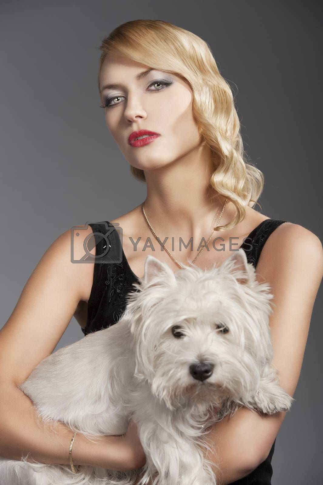 Royalty free image of old fashion blond girl, with dog  by fotoCD