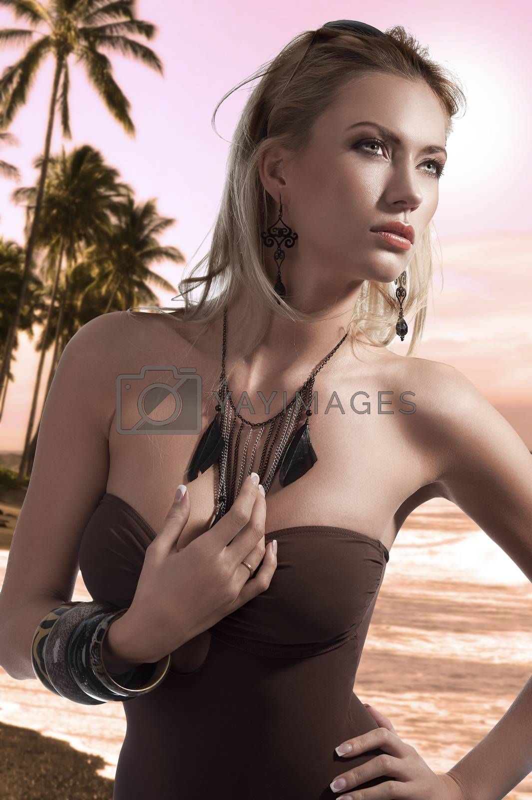 Royalty free image of blonde summer beauty posing in swimsuit by fotoCD