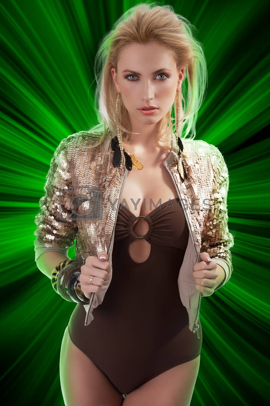 Royalty free image of fashion girl with shining sequins jacket by fotoCD