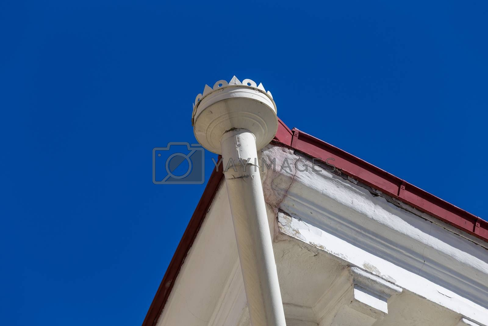 Royalty free image of Rain gutters on old home by RTsubin