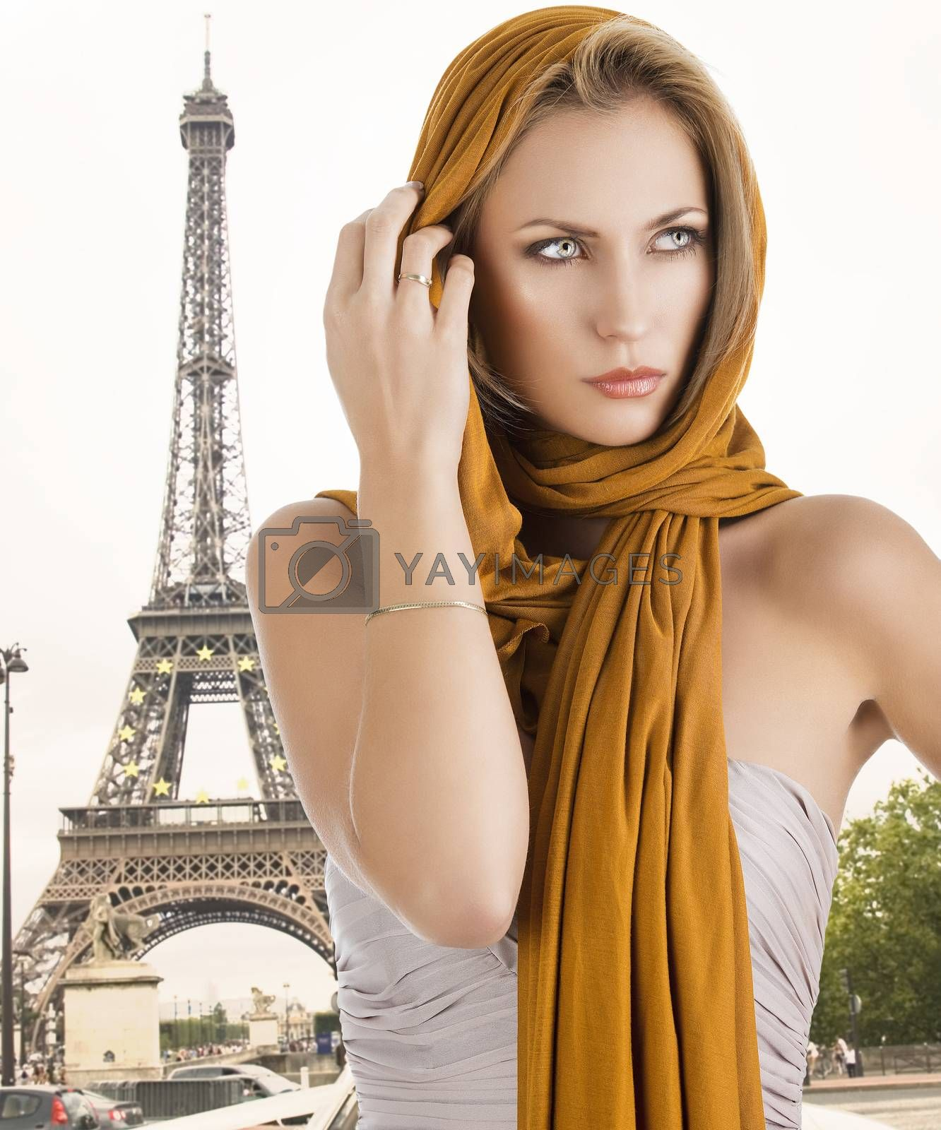 Royalty free image of blond girl in elegant dress, her right hand is near the face by fotoCD