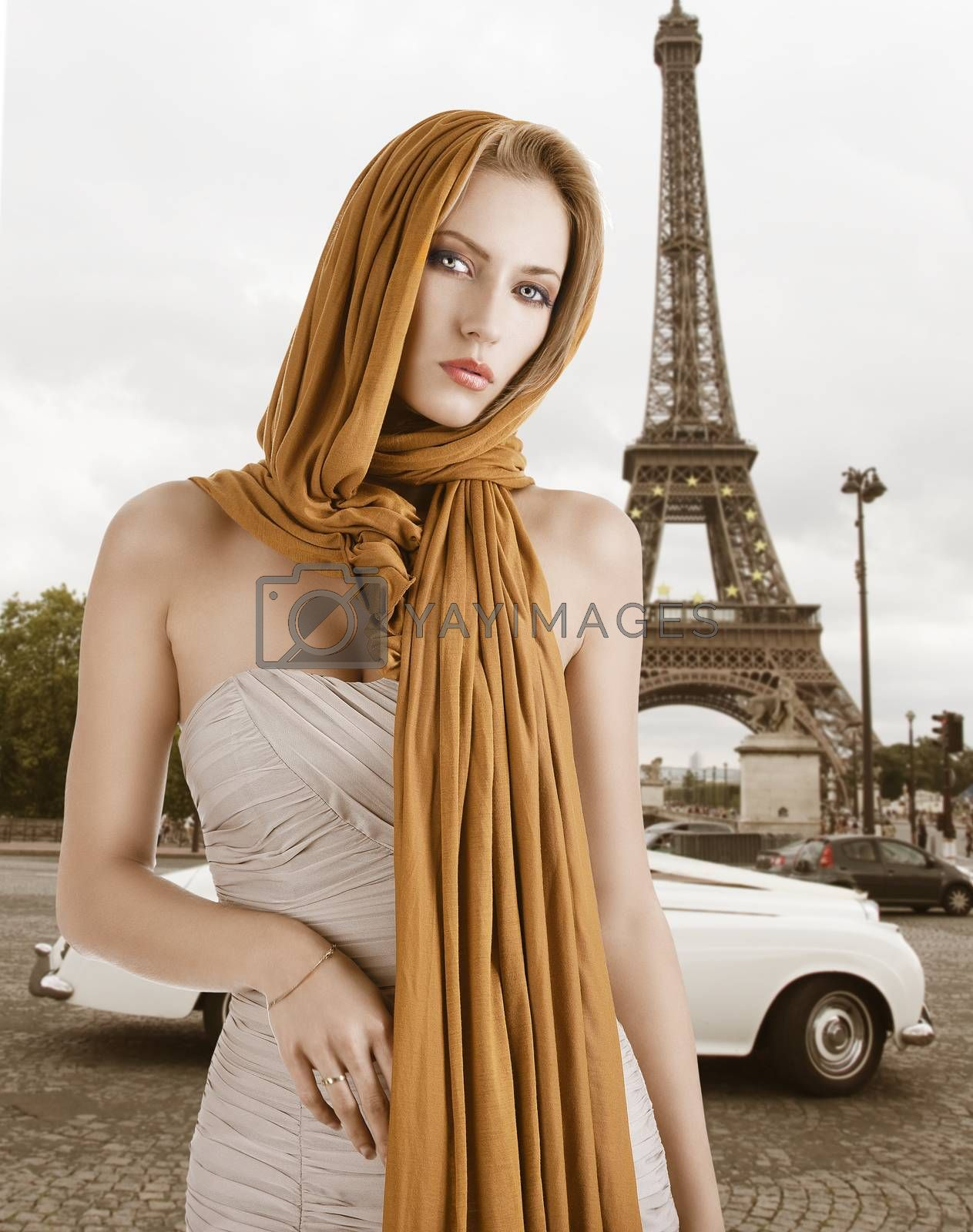 Royalty free image of blond girl in elegant dress, she has the scarf on the head by fotoCD
