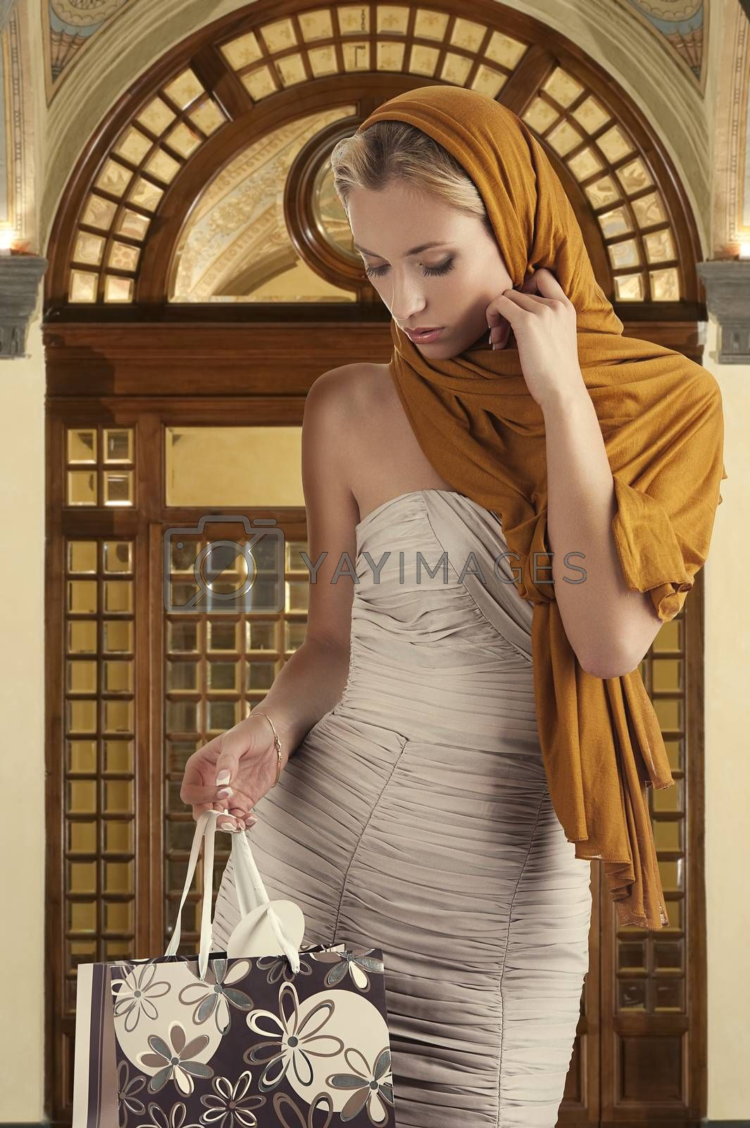 Royalty free image of elegant girl looking in her shopping bag by fotoCD