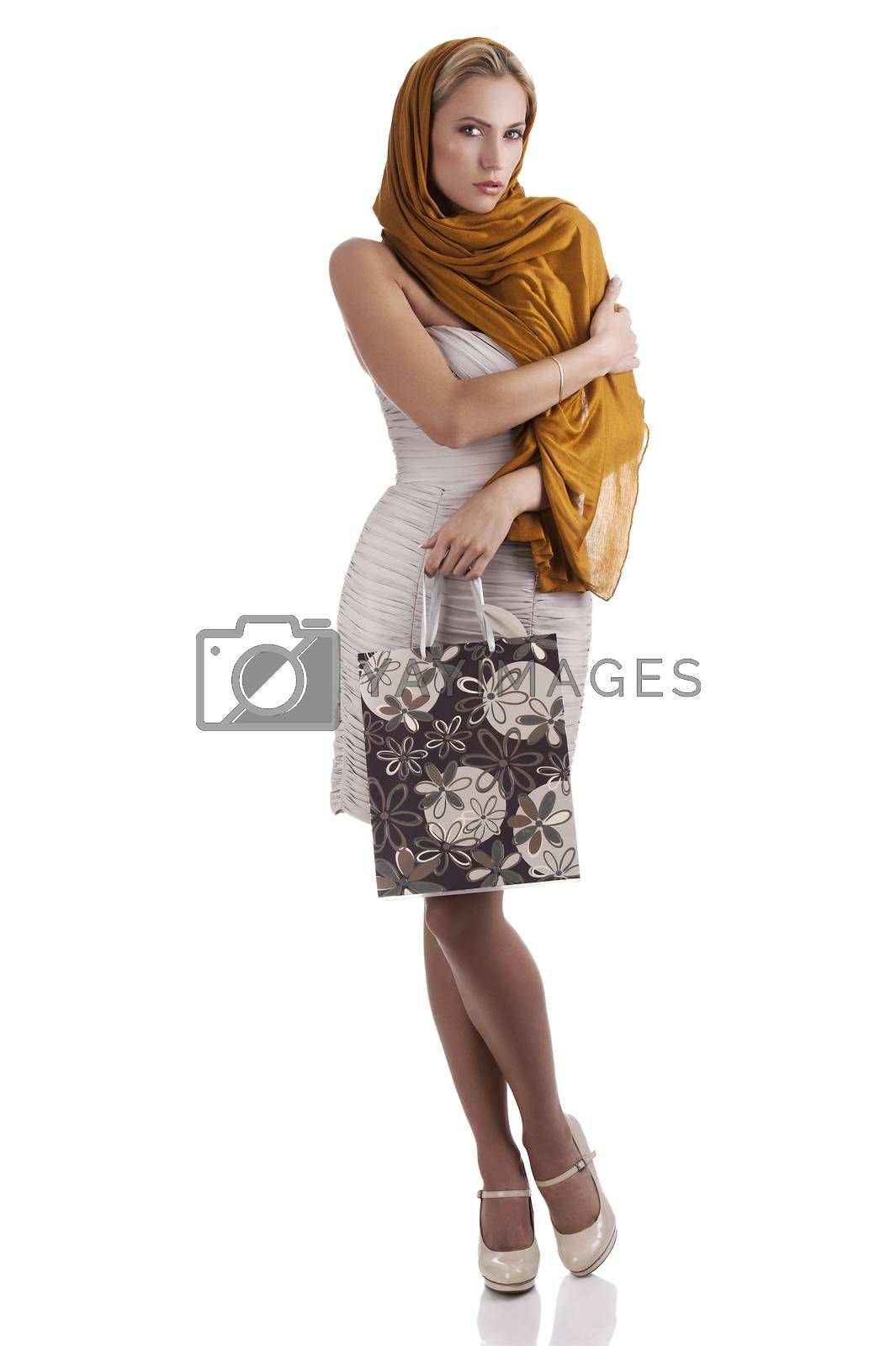 Royalty free image of elegant fashion girl with flower shopping bag by fotoCD