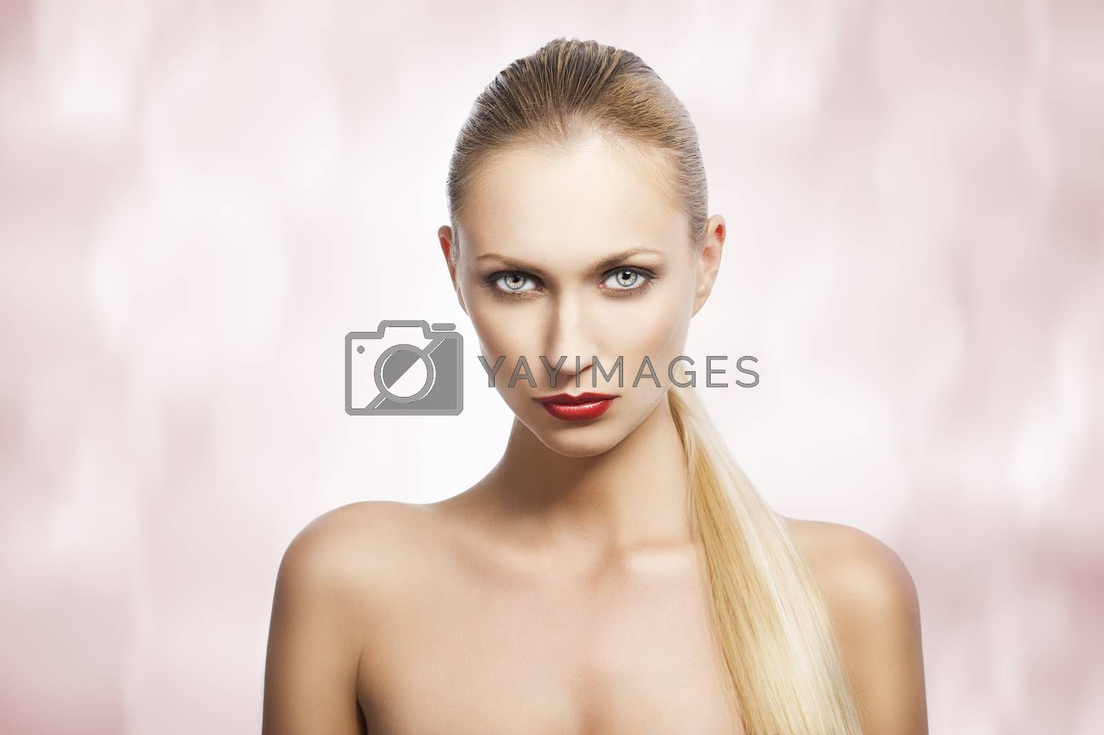 Royalty free image of beauty woman over white. She looks in to the lens by fotoCD