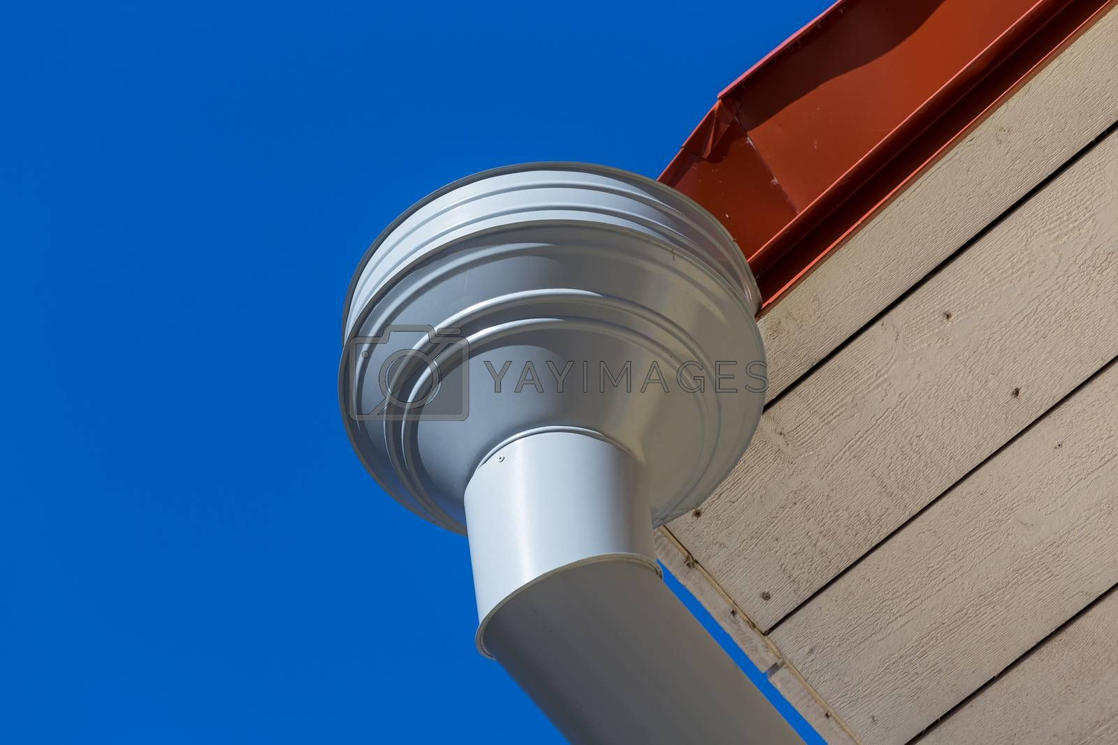 Royalty free image of Rain gutter on house  by RTsubin