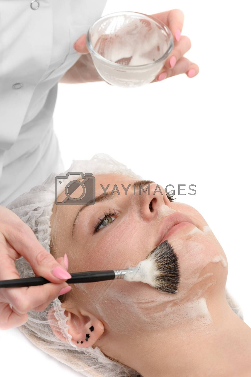 Royalty free image of beauty salon, facial mask applying by starush