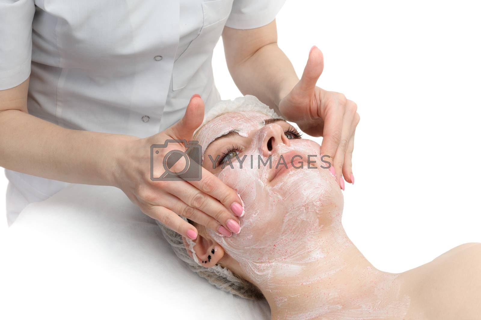 Royalty free image of facial massage with scrub mask  by starush