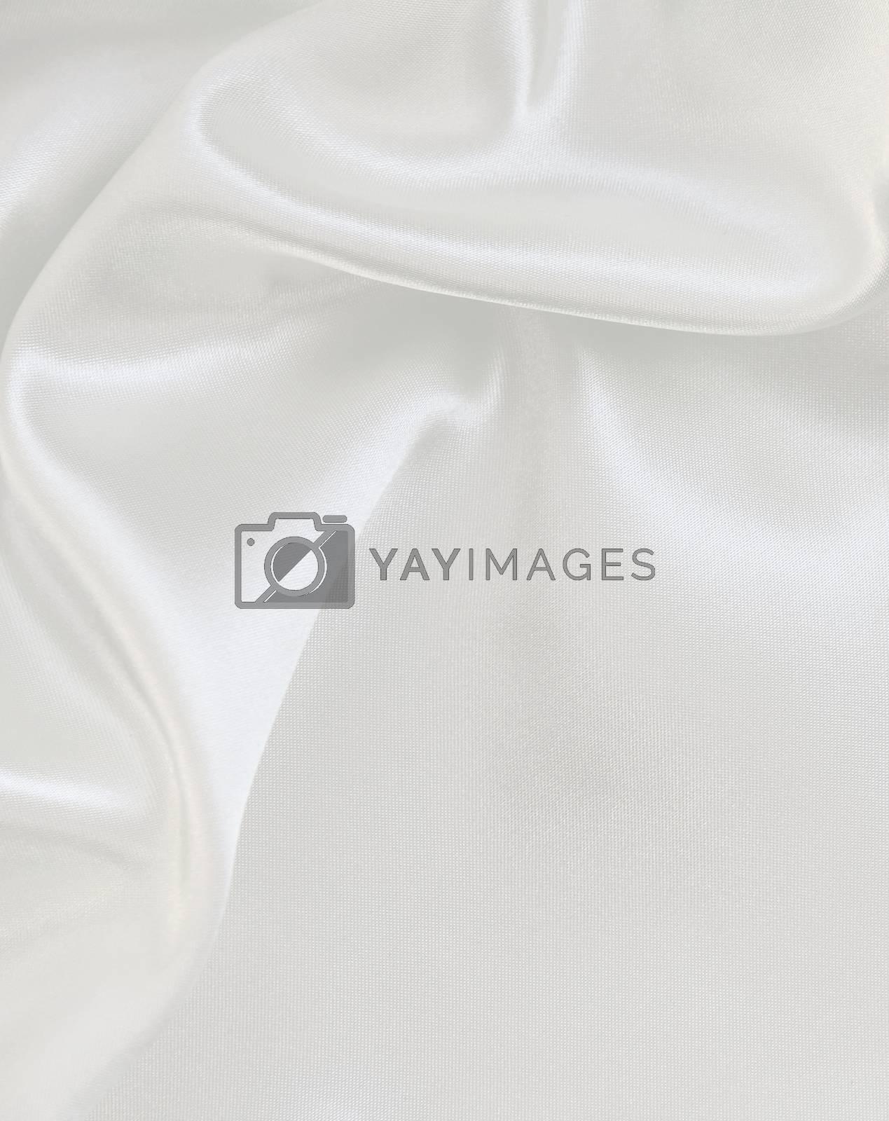 Royalty free image of Smooth elegant white silk as wedding background by oxanatravel