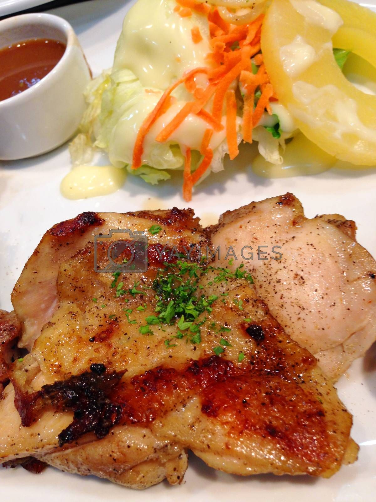 Royalty free image of the chicken steak with pepper sauce and salad by pandara