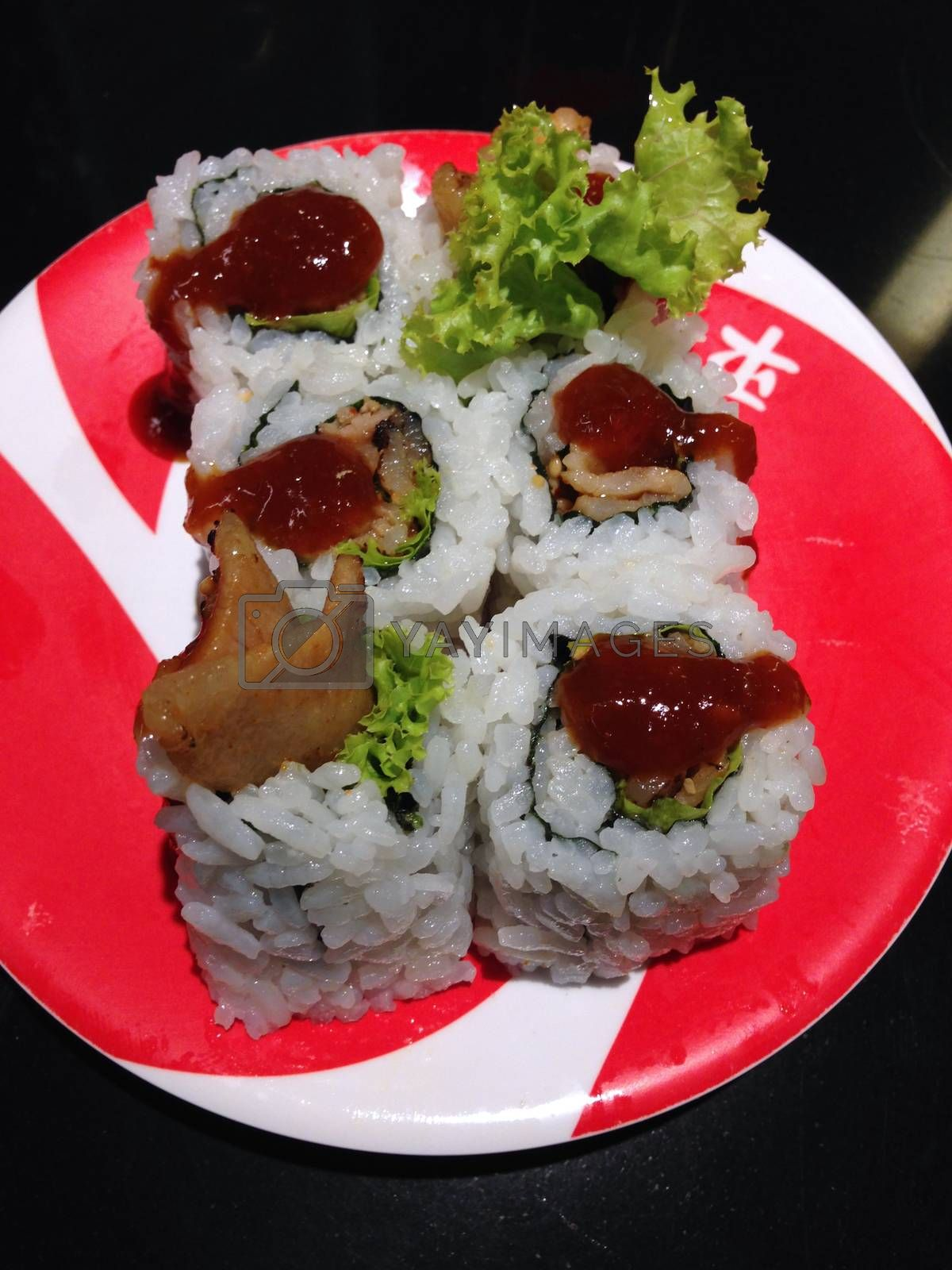 Royalty free image of the dish of sushi with grilled pork by pandara