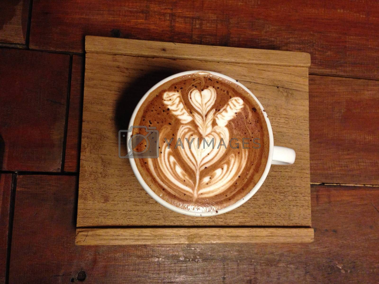 Royalty free image of a cup of coffee with latte art by pandara