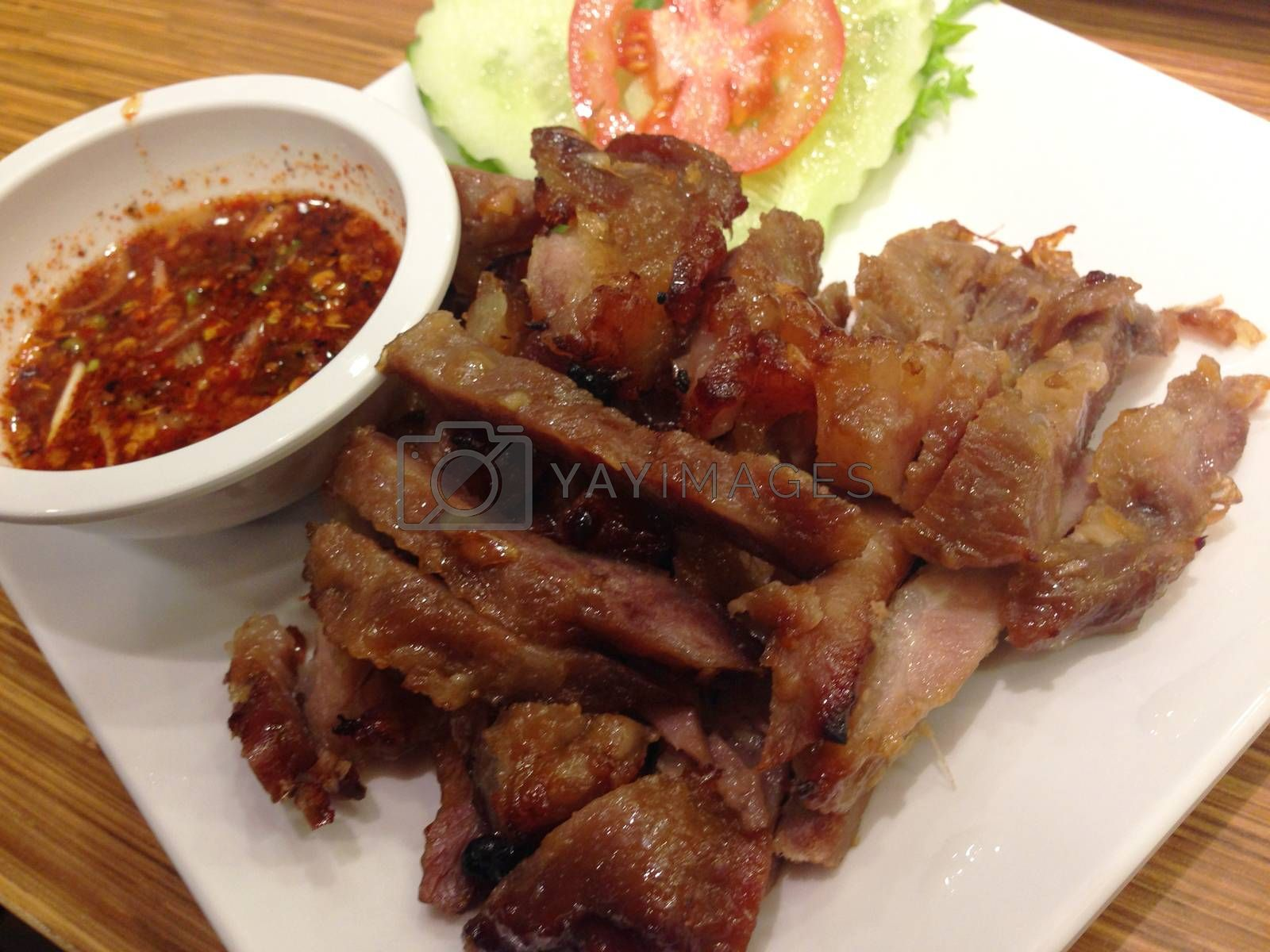 Royalty free image of the dish of grilled pork and spicy sauce , thai food by pandara