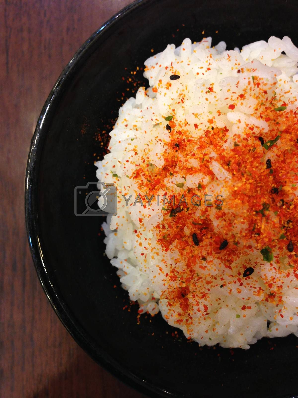 Royalty free image of the bowl of japanese food with chilli power by pandara