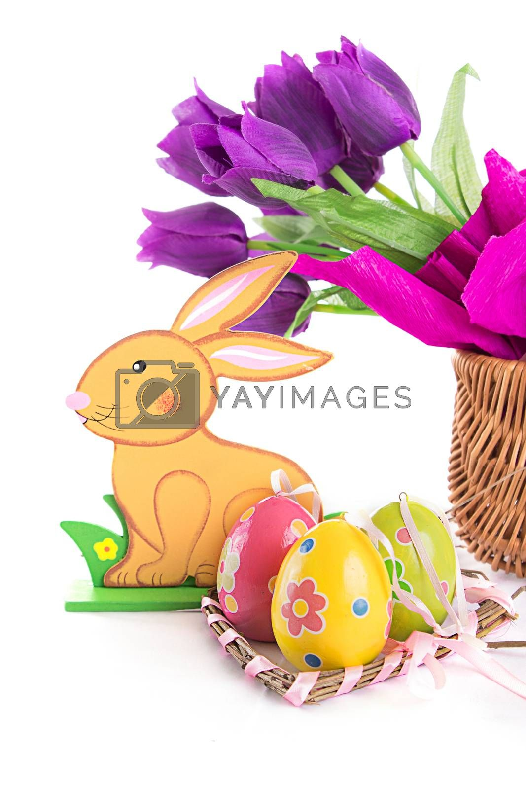 Royalty free image of Easter decoration with rabbit, eggs and tulips by Angel_a